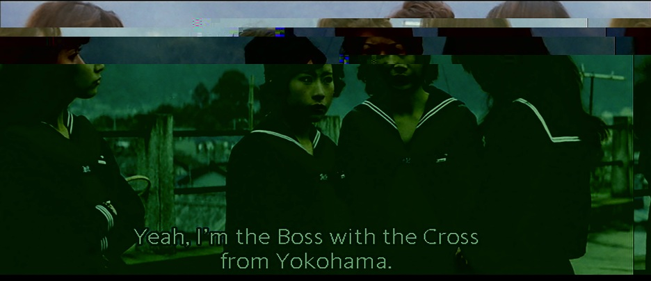 """Yeah, I'm the Boss with the Cross from Yokohama."" Still from Terrifying Girls' High School: Lynch Law Classroom (Suzuki 1973)"